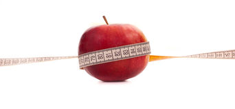 Apple and measurement tape Stock Photo