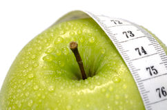 Apple and measurement tape Royalty Free Stock Photos