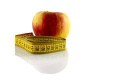 Apple with measurement tool Royalty Free Stock Images