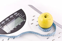 Apple and measuring objects Stock Photography