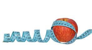 An apple with measuring tape Stock Photography