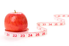 Apple and measuring tape Stock Photo