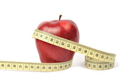 Apple and measuring tape Royalty Free Stock Images