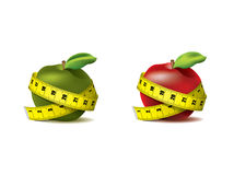 Apple with measuring tape Stock Images