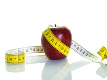Apple and measuring tape. Health cocncept;red apple and measuring tape Stock Images