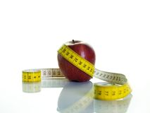 Apple and measuring tape. Health concept;apple with measuring tape Royalty Free Stock Photography