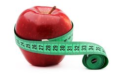 Apple and measuring tape. Isolated over white background Stock Images