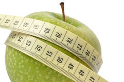Apple and measuring tape Royalty Free Stock Photo