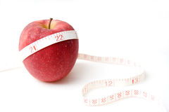 The apple with a measuring tape Stock Images