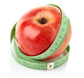 Apple with measuring tape. On white background Royalty Free Stock Photos