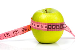 Apple and a measuring tape Royalty Free Stock Photos