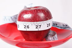 Apple & Measuring Tape Royalty Free Stock Images
