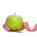 Apple and measuring tape. Isolated on a white Stock Photos