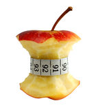 Apple and measuring tape. Isolated on white background Stock Photos