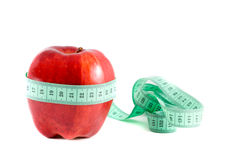 Apple with a measuring tape. Royalty Free Stock Images