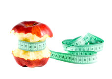 Apple with a measuring tape Stock Photos