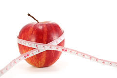 Apple and measuring tape Stock Photos