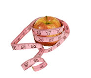 Apple with measuring tape around Royalty Free Stock Photos