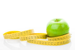 Apple with measuring tape Royalty Free Stock Photo