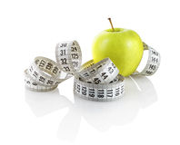Apple with measuring tape Stock Image