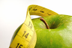 Apple and measuring tape for a healthy lifestyle 1. Apple and measuring tape isolated for a healthy lifestyle Stock Images