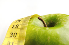 Apple and measuring tape for a healthy lifestyle 3. Apple and measuring tape isolated for a healthy lifestyle Royalty Free Stock Image