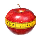 Apple with measuring tape lose weight on white Stock Images