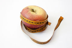 Apple and measuring tape. Tape measure wrapped around the green apple Stock Photography