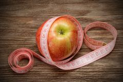 Apple with measuring tape Stock Photography