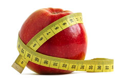 Apple and measuring tape Stock Image