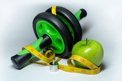 Apple, measuring tape.and simulator Royalty Free Stock Photos