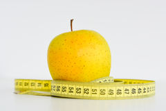 Apple and measuring tape suggesting diet concept Royalty Free Stock Photo