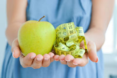 Apple and measuring tape suggesting diet concept Stock Photography