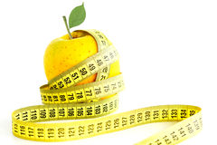 Apple and measuring tape suggesting diet concept Stock Images