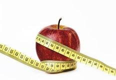 Apple and the measuring tape Stock Photos