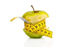 Apple with measuring tape on Stock Photo