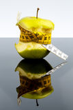 Apple with measuring tape on Royalty Free Stock Photography