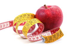 Apple and measuring tape on white Stock Photos