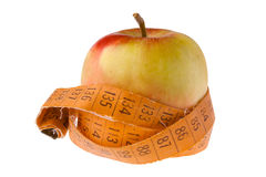 Apple and measuring tape on white Stock Photography