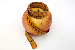 Apple with measuring tape. On a white background Stock Photos