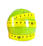 Apple with a measuring tape on a white background Stock Photo