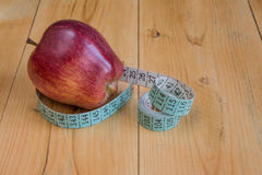 Apple with measuring tape Royalty Free Stock Image