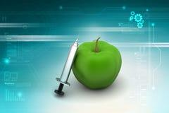 Apple med injektionssprutan Royaltyfri Bild