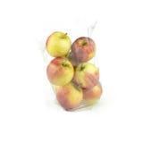 Apple med plast- snedvrider på vit bakgrund Royaltyfri Bild