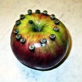 Apple med spikar royaltyfria foton