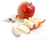 Apple and medical tablets Stock Images