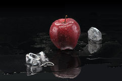 Apple and melting ICE Royalty Free Stock Photography