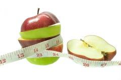 Apple met het meten van band op witte achtergrond 1 Stock Foto