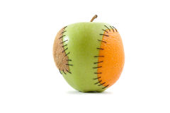 Apple met sinaasappel en kiwiimplant Stock Fotografie