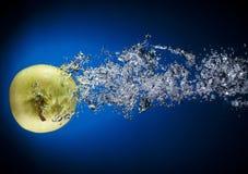 Apple meteor. Apple aquarium on blue background Stock Photo